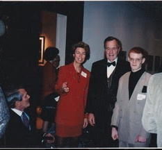 Young Raimondo standing next to Former President George H.W. Bush and Anne Roosevelt at Campaign dinner.