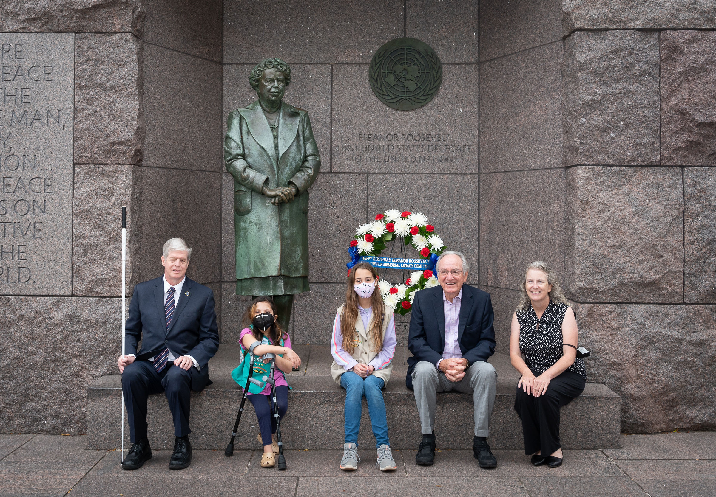 Pictured from left to right: Dr. Kirk Adams, President and CEO of the American Foundation for the Blind (AFB), Ari Paz Pasa, Girl Scout Troop 4720, Eva Lake, Girl Scout Troop 4720, U.S. Senator (Ret) Tom Harkin and Mary Dolan, Co-Founder and Executive Director of the FDR Memorial Legacy Committee commemorate Eleanor Roosevelt's human rights legacy and birthday at the first-ever wreath-laying in her honor at the FDR Memorial in Washington, D.C.