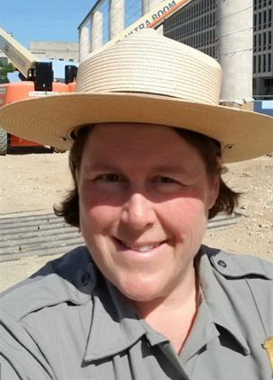 Selfie of Jen Epstein in her NPS uniform while wearing a hat