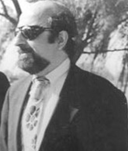 Headshot of Jim Dickson in a suit and tie